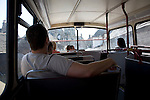 Passengers inside top deck of double decker bus