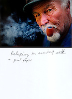 """This is a scan of a print that was given to the subject, Gary Seymour, so that he could write his thoughts. He wrote:..""""Relaxing in evening with a good pipe""""..Ventura, California, July 21, 2010 - A portrait of Gary Seymour at his home, a camper parked left to him by his father that is parked in the driveway of a friend's mother. Because it is an illegal camp, Mr. Seymour is considered homeless. Mr. Seymour has been homeless off and on for the last thirty years. He says, """"I work odd jobs, landscaping and whatnot to make a little money. I am trying to get back on my feet."""" Mr. Seymour is proud that he does not panhandle. """"I earn my own living without asking people for handouts."""" ..."""