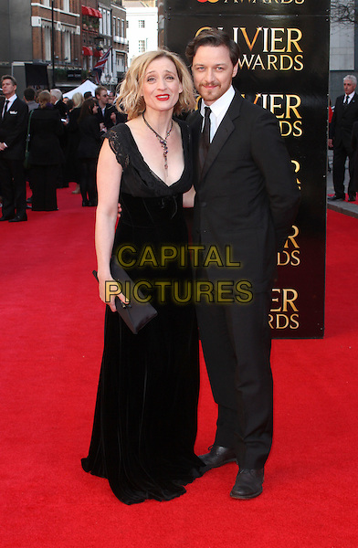 Anne Marie Duff and James McAvoy.The Olivier Awards held at the Royal Opera House, Covent Garden, London, England..April 15th 2012.full length married husband wife black white suit dress necklace clutch bag facial hair beard  .CAP/ROS.©Steve Ross/Capital Pictures