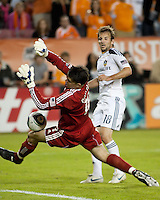 Pat Onstad of the Houston Dynamo attempts the save as Mike Mageeof the Los Angeles looks on during the regular season game between the Los Angeles Galaxy and the Houston Dynamo at Robertson Stadium in Houston, TX on April 10, 2010. Los Angeles 2, Houston 0.