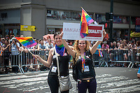 Bi-national couple protests immigration inequality at the 44th annual Lesbian, Gay, Bisexual and Transgender Pride Parade on Fifth Avenue in New York on Sunday, June 30, 2013. The turn out for the parade was especially large with the recent Supreme Court decision overturning the Defense of Marriage Act (DOMA) and California's Proposition 8.  (© Richard B. Levine)