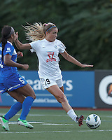 FC Kansas City midfielder Kristie Mewis (19) fakes a shot and dribbles. In a National Women's Soccer League (NWSL) match, Boston Breakers (blue) defeated FC Kansas City (white), 1-0, at Dilboy Stadium on August 10, 2013.