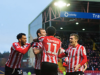 Lincoln City's Matt Rhead, second in from left, celebrates scoring the opening goal with team-mates, from left, Matt Green, Bruno Andrade and Harry Toffolo<br /> <br /> Photographer Chris Vaughan/CameraSport<br /> <br /> The Emirates FA Cup Second Round - Lincoln City v Carlisle United - Saturday 1st December 2018 - Sincil Bank - Lincoln<br />  <br /> World Copyright © 2018 CameraSport. All rights reserved. 43 Linden Ave. Countesthorpe. Leicester. England. LE8 5PG - Tel: +44 (0) 116 277 4147 - admin@camerasport.com - www.camerasport.com