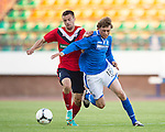 St Johnstone v FC Minsk...01.08.13 Europa League Qualifier at Neman Stadium, Grodno, Belarus...<br /> Murray Davidson and Siarhei Kazeka<br /> Picture by Graeme Hart.<br /> Copyright Perthshire Picture Agency<br /> Tel: 01738 623350  Mobile: 07990 594431