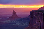 Canyonlands National Park, UT<br /> Breaking sunset light illuminates Candlestick Tower and cliffs at the Green River overlook, Green River Canyon