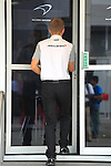 KUALA LUMPUR, MALAYSIA - MARCH 28: McLaren driver Kevin Magnussen of Denmark arrives at the paddock ahead of the first practice session during the Malaysia Formula One Grand Prix at the Sepang Circuit on March 28, 2014 in Kuala Lumpur, Malaysia. (Photo by PETER LIM/PhotoDesk.com.my)