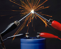 ELECTRICAL DISCHARGE (SPARK) FROM CAPACITOR<br /> Reveals Field Between Two Conductors.<br /> (Coaxial cylindrical type) A capacitor is a combination of two conductors that carry equal and opposite charges. The conductors create an electric field between them. The energy of the capacitor is stored in the electric field.
