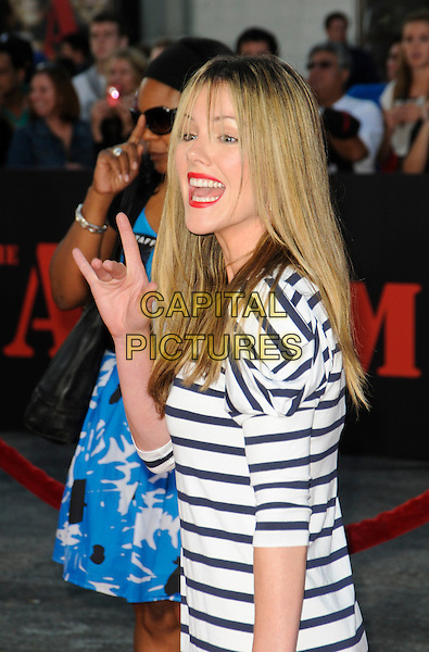 "KATHLEEN ROBERTSON .arriving at the  20th Century Fox premiere of ""The A-Team"" at Grauman's Chinese Theatre in Hollywood, California, USA, June 3rd 2010..half length black and white striped dress hand gesture mouth open funny navy blue .CAP/ROT.©Lee Roth/Capital Pictures"