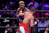 """Fairfax, VA - May 11, 2019: Julian J-Rock"""" Williams catches Hurd with a left hook during Jr. Middleweight title fight at Eagle Bank Arena in Fairfax, VA. Julian Williams defeated Hurd to take home the IBF, WBA and IBO Championship belts by unanimous decision. (Photo by Phil Peters/Media Images International)"""