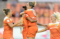 Houston, TX - Saturday July 15, 2017: Poliana Barbosa Medeiros and Morgan Brian celebrate Poliana's goal during a regular season National Women's Soccer League (NWSL) match between the Houston Dash and the Washington Spirit at BBVA Compass Stadium.