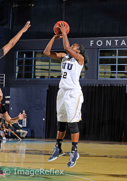 Florida International University guard Jerica Coley (22) plays against Barry University. FIU won the game 66-52 on November 1, 2013 at Miami, Florida.