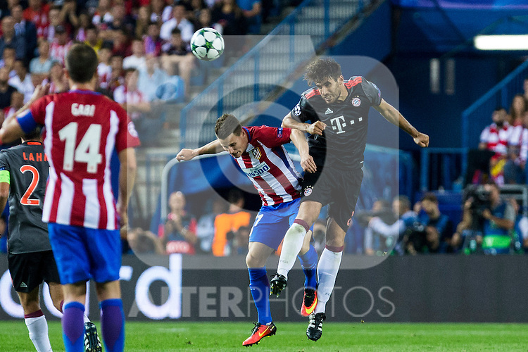 Atletico de Madrid's Kevin Gameiro and Bayern Munich's Javi Martinez during the match of Group stage of Champions League Atletico de Madrid and Bayern Munich at Vicente Calderon Stadium in Madrid. September 28, 2016. (ALTERPHOTOS/Rodrigo Jimenez)
