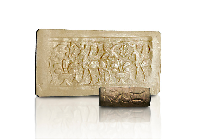 Hittite cylinder seal depicting a scene of animals, seal in foreground and impression standing behind.. Adana Archaeology Museum, Turkey. Against a white background