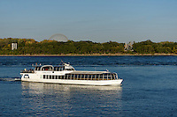 Le Bateauu Mouche cruise boat on the St. Lawrence River with St. Helen's Island in back, Montreal, Quebec, Canada