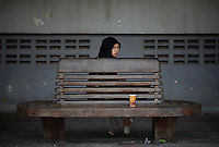 A Muslim girl waits for a train at a station in the troubled Yala province in the southern Thailand February 28, 2011. Separatists are blamed for most of the attacks on Thailand's predominantly Muslim deep south, which often target Buddhists and Muslims associated with the Thai state, such as police, soldiers, government officials and teachers. No credible group has claimed responsibility for near daily drive-by shootings and bombings, which continue unabated, despite a massive counterinsurgency effort. Yala and Pattani are two of three Muslim-dominated provinces bordering Malaysia where more than 4,300 people, both Muslims and Buddhists, have been killed in a low-level insurgency since 2004.   REUTERS/Damir Sagolj (THAILAND)