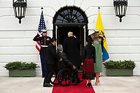 United States President Donald J. Trump salutes as he enters the White House with First lady Melania Trump, President of Ecuador Lenín Moreno, and his wife Rocio Gonzales De Moreno in Washington D.C., U.S. on Wednesday, February 12, 2020.  <br /> <br /> Credit: Stefani Reynolds / CNP/AdMedia