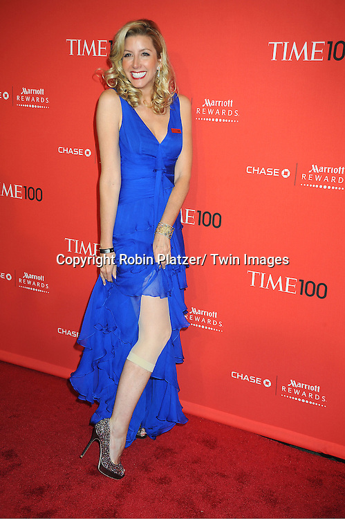 honoree Sara Blakely, who invented Spanks, showing hers,  attends The Time 100 Most Influential People in the World Gala on April 24, 2012 at Frederick P Rose Hall at Lincoln Center in New York City. .