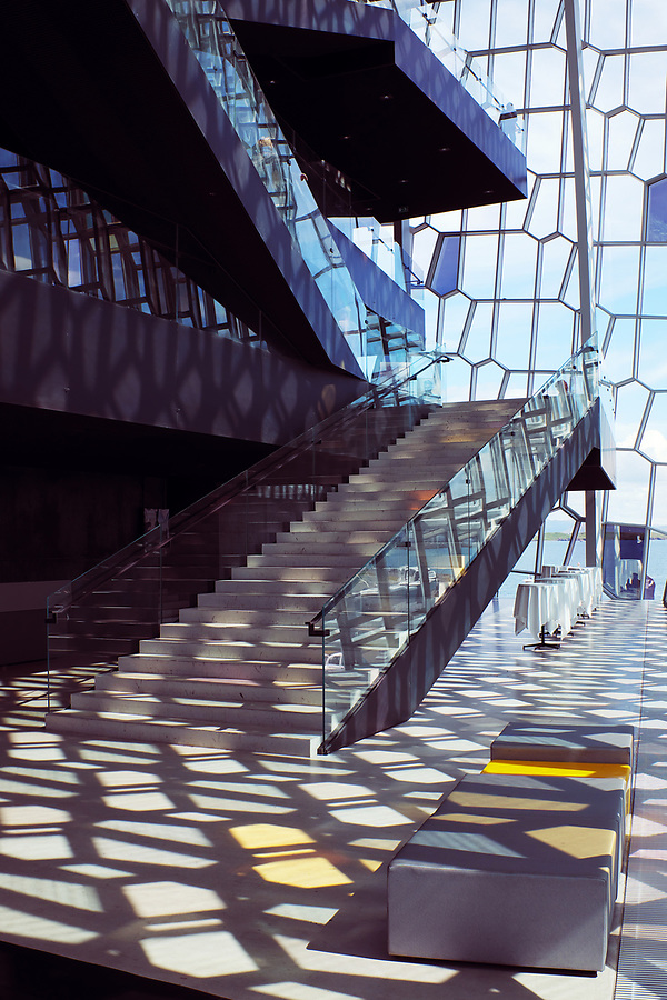 Interior staircase and glass facade of Harpa Concert Hall, Reykjavik, Iceland