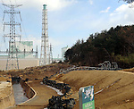 February 20, 2012, Fukushima, Japan - A steel tower destroyed by the March 11, 2011 earthquake and tsunami lies on the premises of the Fukushima No. 1 Nuclear Power Plant in Futaba, Fukushima Prefecture, on Feb. 20, 2012. In the rear, from left to right, are the plant's No. 6 and No. 5 reactor buildings. The disaster caused a major power loss needed to cool down the plant's nuclear reactors.