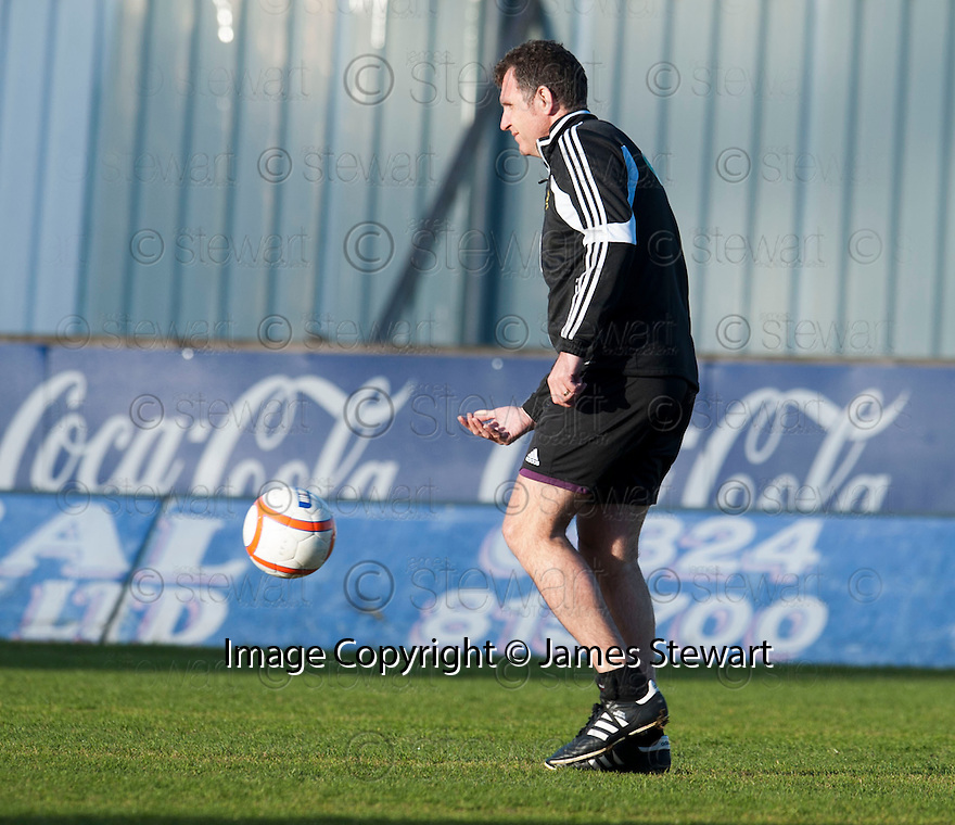 Referee John McKendrick who was out on the park for nearly 20 minutes worrying about the strong wind before eventually giving the green light for the game to go ahead.
