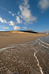 Waves lapping on the golden beaches of Playa de Sotavento de Jandia,  Fuerteventura, Canary Islands,Spain.
