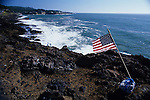 American flag on rocky coastline along Highway 101 after nine eleven 9/11 Depoe Bay, Oregon Coast Oregon State  USA