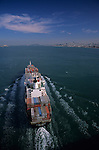 Looking down on a tanker going into San Francisco Bay with San Francisco skyline in background, Califronia USA