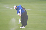 Graeme McDowell plays his 3rd shot in the torrential rain on the 2nd hole during the morning Fourball Match 2  during Day 1 of the The 2010 Ryder Cup at the Celtic Manor, Newport, Wales, 29th September 2010..(Picture Eoin Clarke/www.golffile.ie)