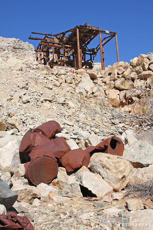 Stamp mill and empty powder barrels at the Lost Burro Gold Mine in Death Valley National Park. The Lost Burro Gold Mine was given its name in 1907 when Bert Shively's burro decided he'd had it and went to get himself lost. Bert caught up with him in a remote canyon and picked up a rock to get his attention. He never threw the rock at the animal as it was laced with gold. The mine was worked off and on through the decades according to the price of gold up into the 1970's. No one seems to know what happened to the burro.