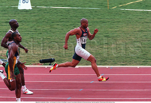 MAURICE GREENE (USA),  on his way to victory in the Men's 200m Final, World Athletics Championships, Seville 990827 Photo:Glyn Kirk/Action Plus...1999.sprint.sprinter.sprinting.man.track and field..male