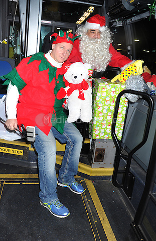 STATEN ISLAND, NY - DECEMBER 21: Comedian Mike Marino and actor Vincent Pastore dresses as Santa during the Kids Against Cancer Toy Drive at the Staten Island Bus Depot in New York City on December 21, 2016. Credit: Dennis Van Tine/MediaPunch