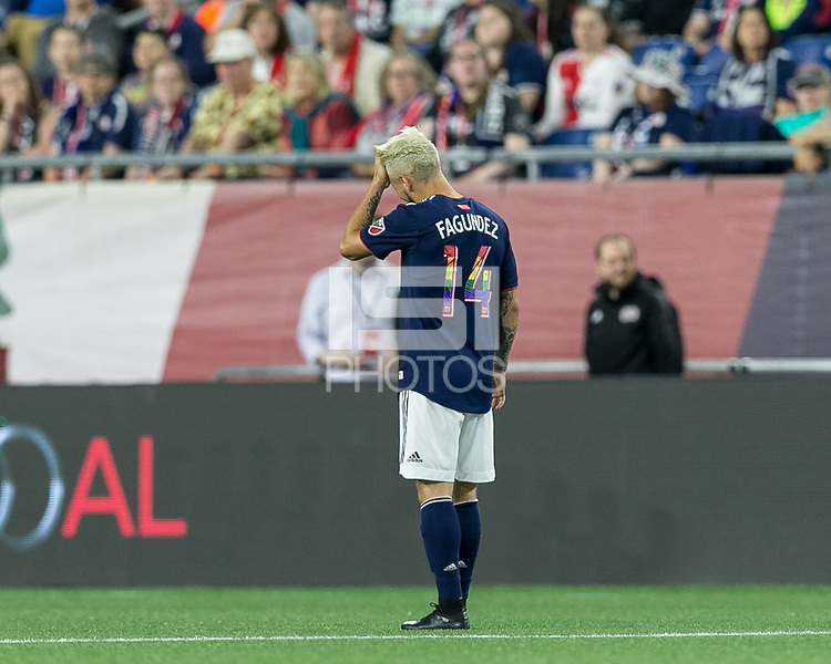 Foxborough, Massachusetts - June 2, 2018: In a Major League Soccer (MLS) match, New England Revolution (blue/white) defeated New York Red Bulls (white), 2-1, at Gillette Stadium.<br /> Diego Fagundez with pride number jersey.