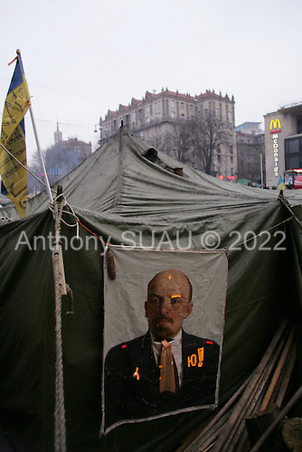 "Kiev, Ukraine.December 27, 2004..Tents set along Kreshatik, the central street in Kiev where demonstrators lived for nearly a month to overturn what they felt was a rigged election. In a second round of voting, that they won, the polls show Viktor Yushchenko, the opposition candidate, in a strong lead over Viktor Yanukovich with 98% of the vote counted. ..The first round of voting was considered fraudulent when the ruling president Viktor Yahukovich won and the opposition candidate Viktor Yushchenko lost. ..Several hundred thousand Ukrainians took to the streets of Kiev and held daily rallies on Maidan Independence Square. The protests lasted nearly a month before the first vote was declared invalid and a new round of elections held on December 26, 2004. ..The demonstrations would come to be known as the ""Orange Revolution"" after the color of the opposition party."