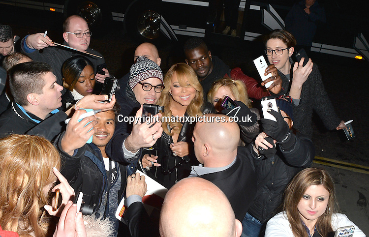 NON EXCLUSIVE PICTURE: MATRIXPICTURES.CO.UK<br /> PLEASE CREDIT ALL USES<br /> <br /> WORLD RIGHTS <br /> <br /> Mariah Carey is spotted as she arrives back at her hotel, following a gig in Cardiff.<br /> <br /> The singer, who is in the UK for the European leg of her Sweet Sweet Fantasy tour, appears to be in high spirits as she smiles at awaiting fans and stops for selfies.<br /> <br /> Mariah shows off her cleavage in a plunging black gown and completes her look with a Gucci leather jacket. <br /> <br /> MARCH 21st 2016<br /> <br /> REF: LTN 16769