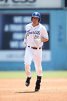 Shane Hoelscher (22) of the Asheville Tourists rounds the bases after hitting a home run against the Asheville Tourists at McCormick Field on July 26, 2015 in Asheville, North Carolina.  The Tourists defeated the Braves 16-4.  (Brian Westerholt/Four Seam Images)