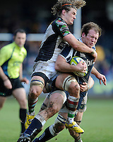 20130317 Copyright onEdition 2013©.Free for editorial use image, please credit: onEdition..Henry Thomas of Sale Sharks is tackled by Luke Wallace (left) and Sam Twomey of Harlequins during the LV= Cup Final between Harlequins and Sale Sharks at Sixways Stadium on Sunday 17th March 2013 (Photo by Rob Munro)..For press contacts contact: Sam Feasey at brandRapport on M: +44 (0)7717 757114 E: SFeasey@brand-rapport.com..If you require a higher resolution image or you have any other onEdition photographic enquiries, please contact onEdition on 0845 900 2 900 or email info@onEdition.com.This image is copyright onEdition 2013©..This image has been supplied by onEdition and must be credited onEdition. The author is asserting his full Moral rights in relation to the publication of this image. Rights for onward transmission of any image or file is not granted or implied. Changing or deleting Copyright information is illegal as specified in the Copyright, Design and Patents Act 1988. If you are in any way unsure of your right to publish this image please contact onEdition on 0845 900 2 900 or email info@onEdition.com