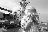 - Italian Navy, Vittorio Veneto cruiser, flight deck, fire safety personnel (May 1984)<br />