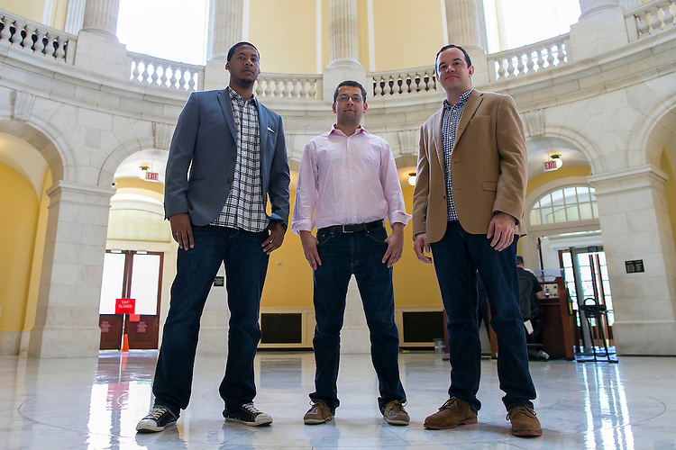 UNITED STATES - August 14: From left, Brandon Gassaway, Press Secretary, Joe Lustig, Legislative Assistant, and Peter Hunter, Senior Legislative Assistant,  all for the office of Rep. Cedric Richmond, D-La., pose for a portrait in the Cannon House Office Building on Capitol Hill in Washington, on Friday, August 14, 2015<br /> (Photo By Al Drago/CQ Roll Call)