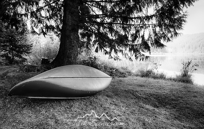 Idaho, North Central, Elk River. A canoe on the shore of Elk Creek Reservoir.