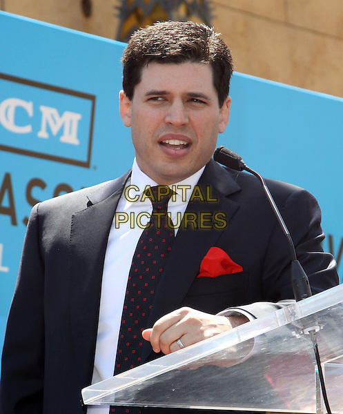 MAX BROOKS .Mel Brooks is honoured with the 2406th star on the Hollywood Walk of Fame held On Hollywood Blvd., Hollywood, California, USA, 23 April 2010..half length navy blue jacket suit tie microphone speaking podium suit son family red polka dot .CAP/ADM/KB.©Kevan Brooks/Admedia/Capital Pictures
