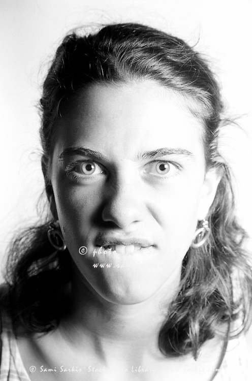 Portrait of a young woman making faces into the camera.