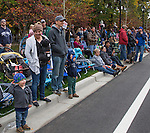 Naomi, Jason, 2-year old Caleb and 4-year old Lewis Ching, left, from Carson City watch the Nevada Day Parade on Saturday, October 29, 2016.