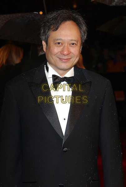 ANG LEE.The 2006 Orange British Academy Film Awards, Odeon Leicester Square, London, UK..February 19th, 2006.Ref: BEL.half length black tuxedo bow tie bafta baftas.www.capitalpictures.com.sales@capitalpictures.com.© Capital Pictures.