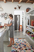 The kitchen has a central island unit and shelving constructed from traditional tadelakt plaster.