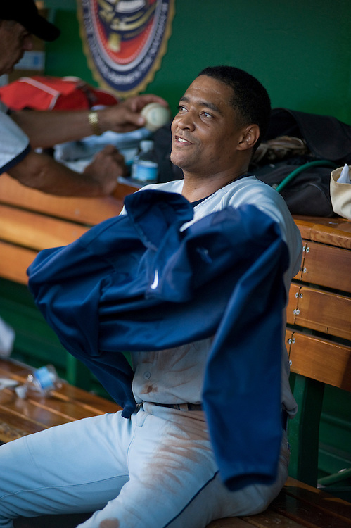 UNITED STATES - JULY 14:  Starting pitcher Rep. Cedric Richmond, D-La., takes a break in the dugout after the 50th Annual Congressional Baseball Game at Nationals Park.  The Democrats prevailed over the Republicans by the score of 8-2.  (Photo By Tom Williams/Roll Call)