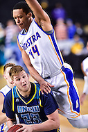MAR 7, 2016: Baltimore, MD - North Carolina-Wilmington Seahawks center C.J. Gettys (23) is fouled over the back by Hofstra Pride forward Andre Walker (44) during the Championship game of the CAA Basketball Tournament at Royal Farms Arena in Baltimore, Maryland. (Photo by Philip Peters/Media Images International)