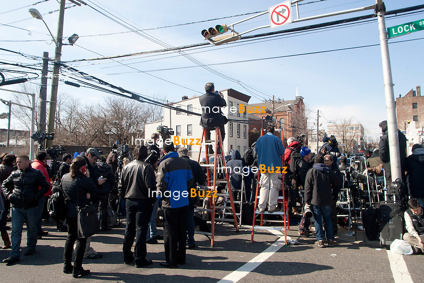 NEWARK, NJ - FEBRUARY 18 :  Family members and guests attend the Whitney Houston's funerals at 'The New Hope Baptist Church' on February 18, 2012 in Newark, New Jersey. Whitney Houston was found dead in her hotel room at The Beverly Hilton hotel on February 11, 2012. .Pic :  the media across the street from The New Hope Baptist Church.................