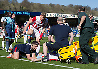 Jack Barthram of Cheltenham Town lies injured and receives attention after colliding with his goalkeeper Rob Lainton of Cheltenham Town (on loan from Bury) during the Sky Bet League 2 match between Wycombe Wanderers and Cheltenham Town at Adams Park, High Wycombe, England on the 8th April 2017. Photo by Liam McAvoy.