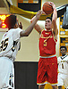 Michael O'Connell #5 , Chaminade freshman, right, pulls up for a jumper during a CHSAA varsity boys basketball game against host St. Anthony's High School on Friday, Jan. 20, 2017.