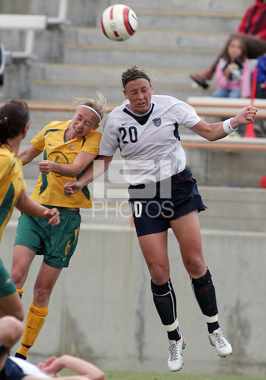 Abby Wambach heads the ball in front of Australia's Rhian Davies in the first half in Fullerton, Calif., Sunday, Oct. 16, 2005. The USA tied Australia 0-0.